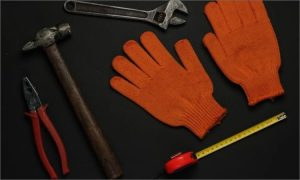 leather gloves and tools